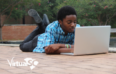 Boy Studying near fountain